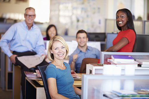 group of people at the office smiling